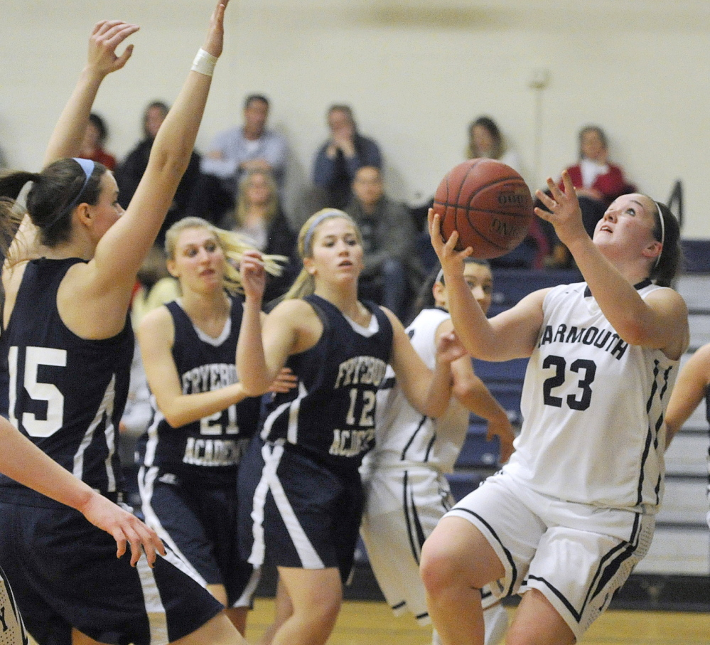 Abigail Nielsen of Yarmouth finds room to drive against the Fryeburg Academy defense, including, left to right, Alexis L'Heureux-Carland, Sage Boivin and Makayla Frost, during Fryeburg's 35-22 victory Tuesday night at Yarmouth High.