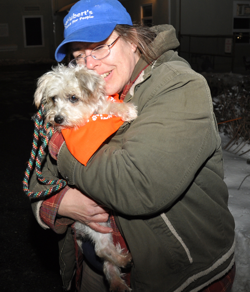 Melissa Morgan, a kennel attendant and adoption counselor, holds Josie, a terrier/poodle mix, last month at St. Hubert's Animal Welfare Center in Madison, N.J. Josie was one of 45 dogs brought to New Jersey from overcrowded shelters in Tennessee. Nearly all have been adopted.