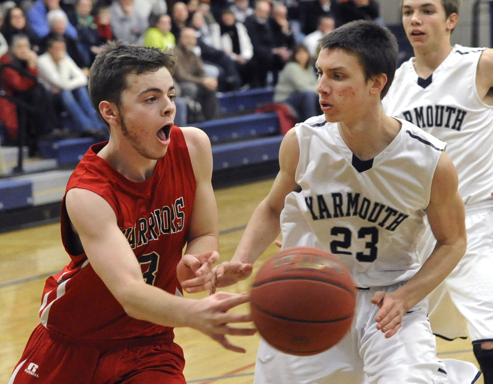 Nate Booth of Wells passes the ball along the baseline in front of Ben Still of Yarmouth during Yarmouth's 72-51 victory Wednesday.