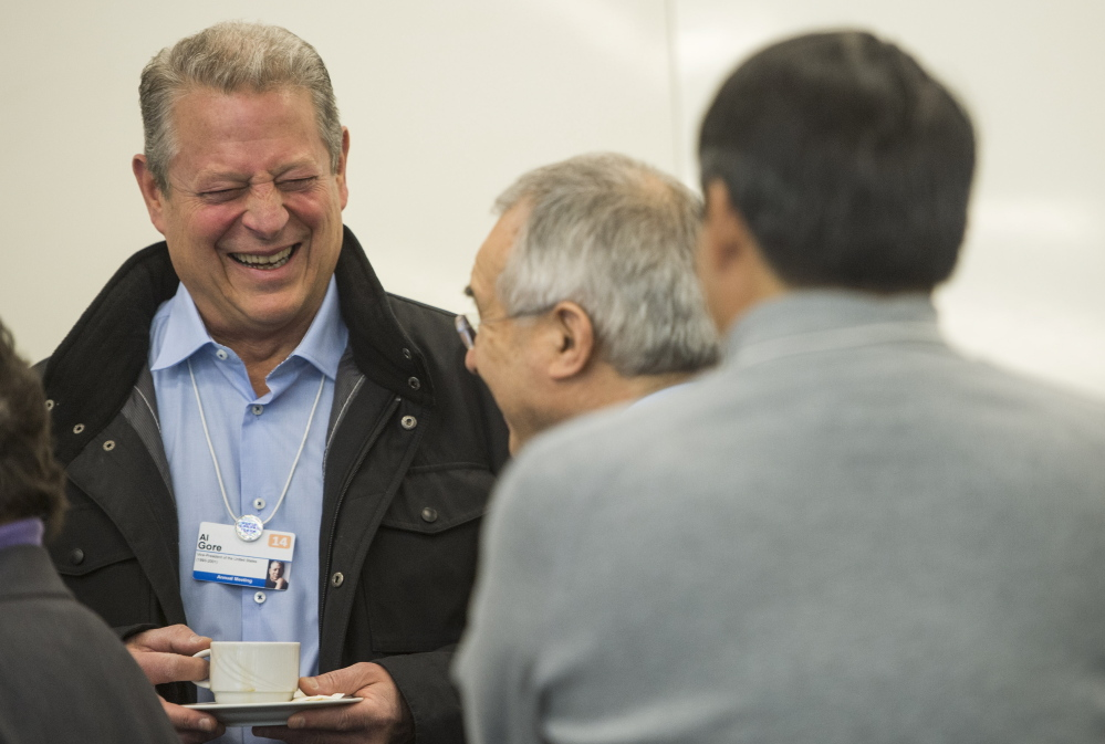 Former Vice President Al Gore laughs prior to a panel session on Wednesday as the annual World Economic Forum opens in Davos, Switzerland.