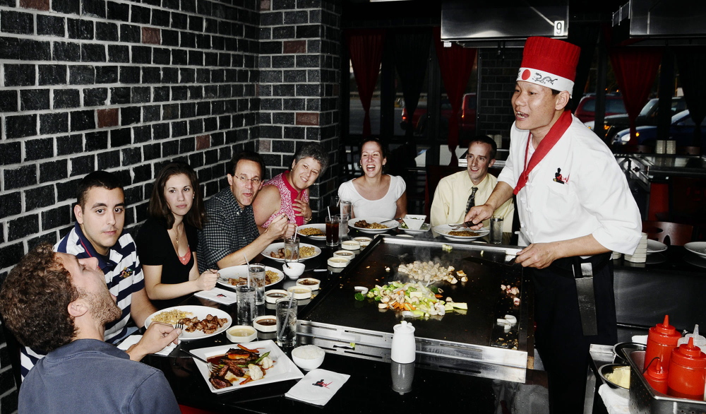A hibachi chef provides both dinner and entertainment at Kon Asian Bistro in Portland.