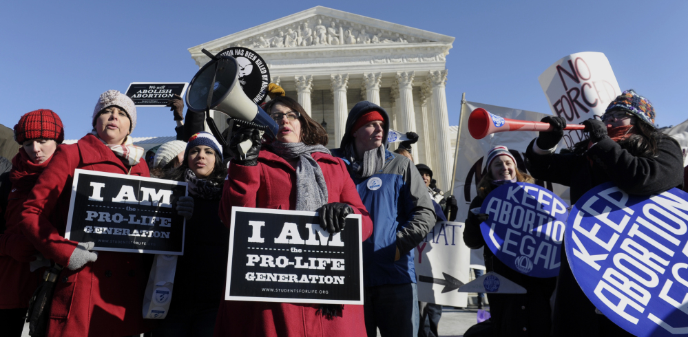 Protesters on both sides of the abortion debate rally outside the Supreme Court in Washington on Wednesday, where wind chills were in the single digits.