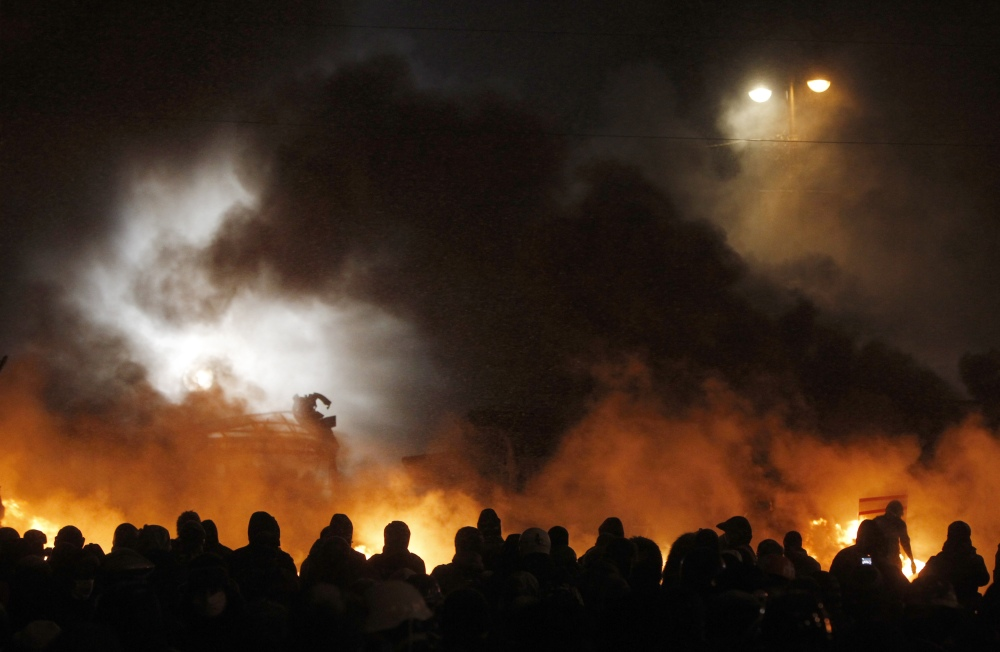 Protesters clash with police in central Kiev, Ukraine, on Wednesday.