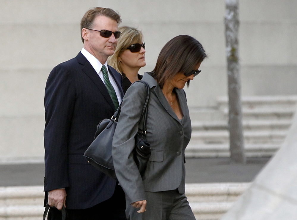 Former Deutsche Bank executive Brian Mulligan arrives with his wife Victoria, center, at the Edward R. Roybal Federal Building in Los Angeles on Tuesday, to pursue an excessive force suit against two Los Angeles police officers. A civilian oversight board found the officers' use of force appropriate.