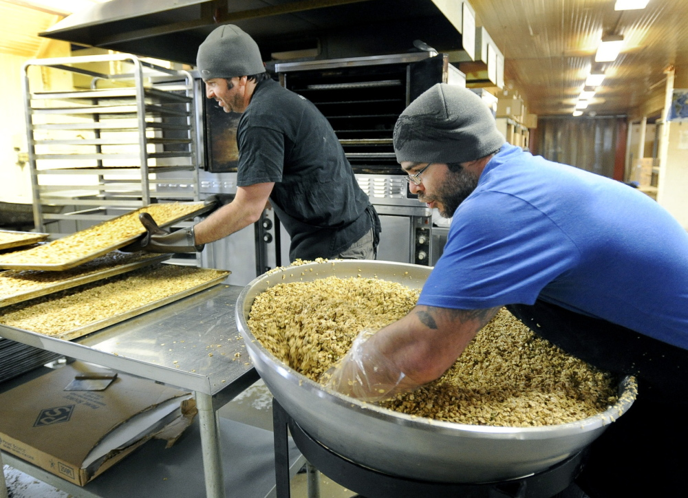 Erik Hanrahan and Alex Trojano mix and bake classic granola at GrandyOats in Brownfield. The company is moving to a larger facility in Hiram.
