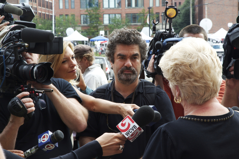 Director Joe Berlinger, center, interviews Pat Donahue in the documentary film,