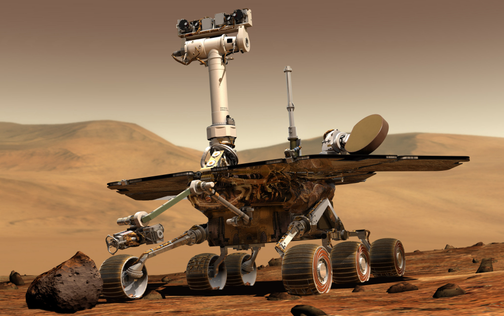 An artist rendering released by NASA shows the rover Opportunity on the surface of Mars. Opportunity landed on the red planet on Jan. 24, 2004, and is still exploring. Its twin Spirit stopped communicating in 2010. It costs about $14 million a year to maintain Opportunity.