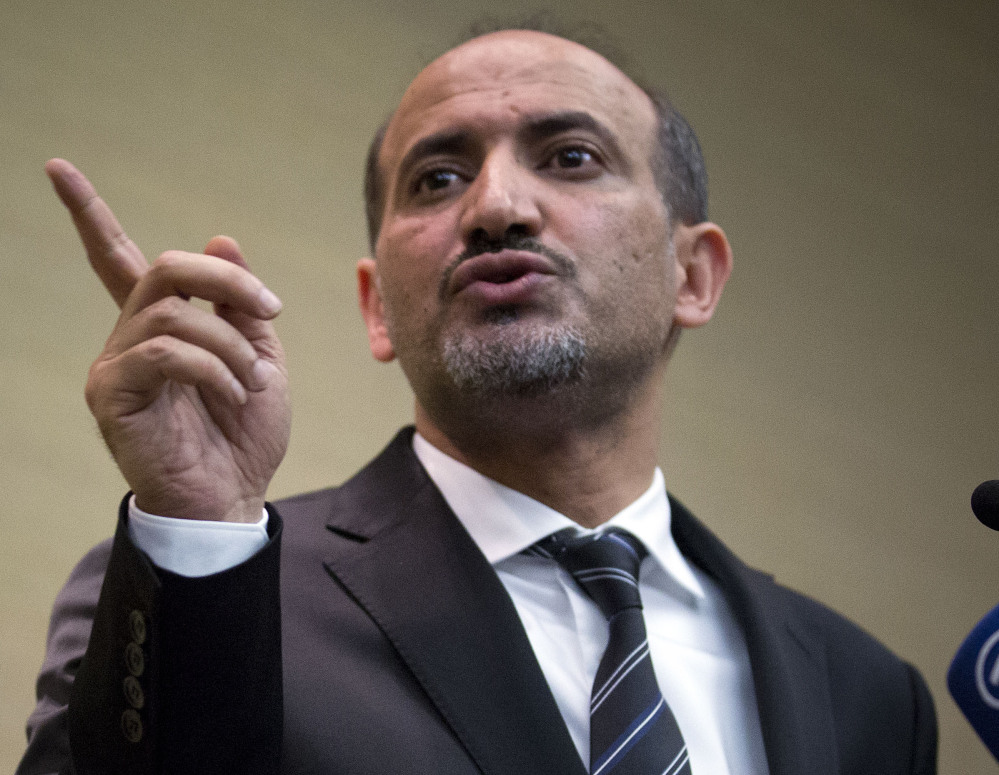 Ahmad al-Jarba, leader of the Syrian National Coalition, Syria's main political opposition group, speaks at a news conference in Geneva, Switzerland, on Thursday.