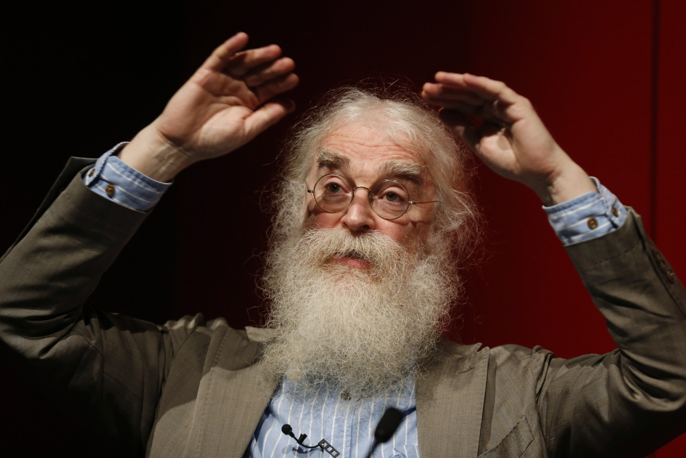 """Irving Finkel, curator in charge of cuneiform clay tablets at the British Museum, speaks to the media during the launch of his book, """"The Ark Before Noah,"""" at the British Museum in London on Friday."""