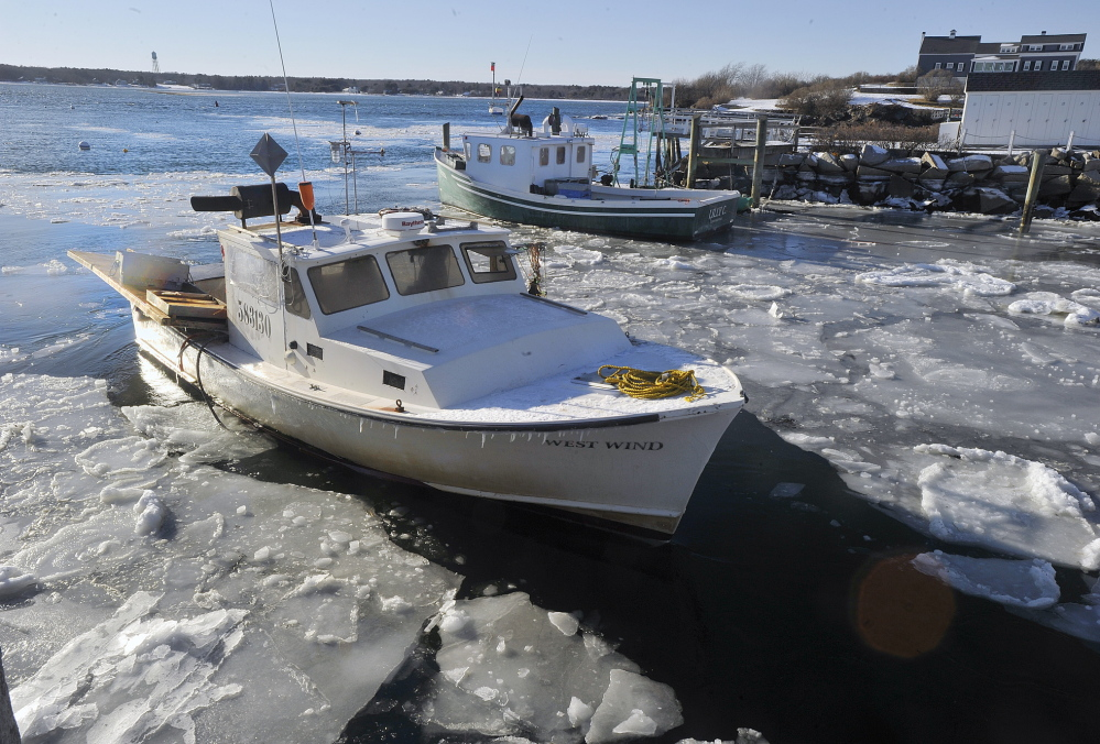 The lobster boat West Wind breaks through ice floes on its way to the fish pier at Biddeford Pool on Friday. So far, this is the coldest Maine winter since 2002-2003.