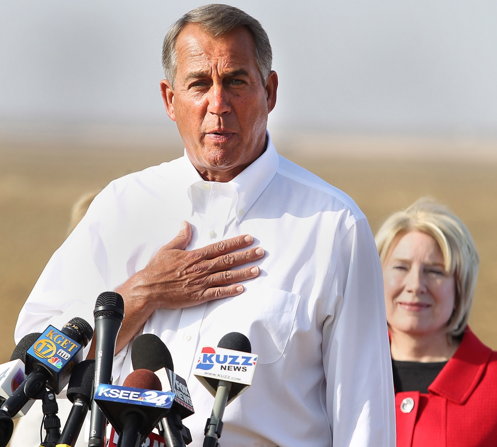 """House Speaker John Boehner talks about the drought Wednesday near Bakersfield, Calif., with state Sen. Jean Fuller. He appeared on the """"Tonight Show"""" on Thursday."""