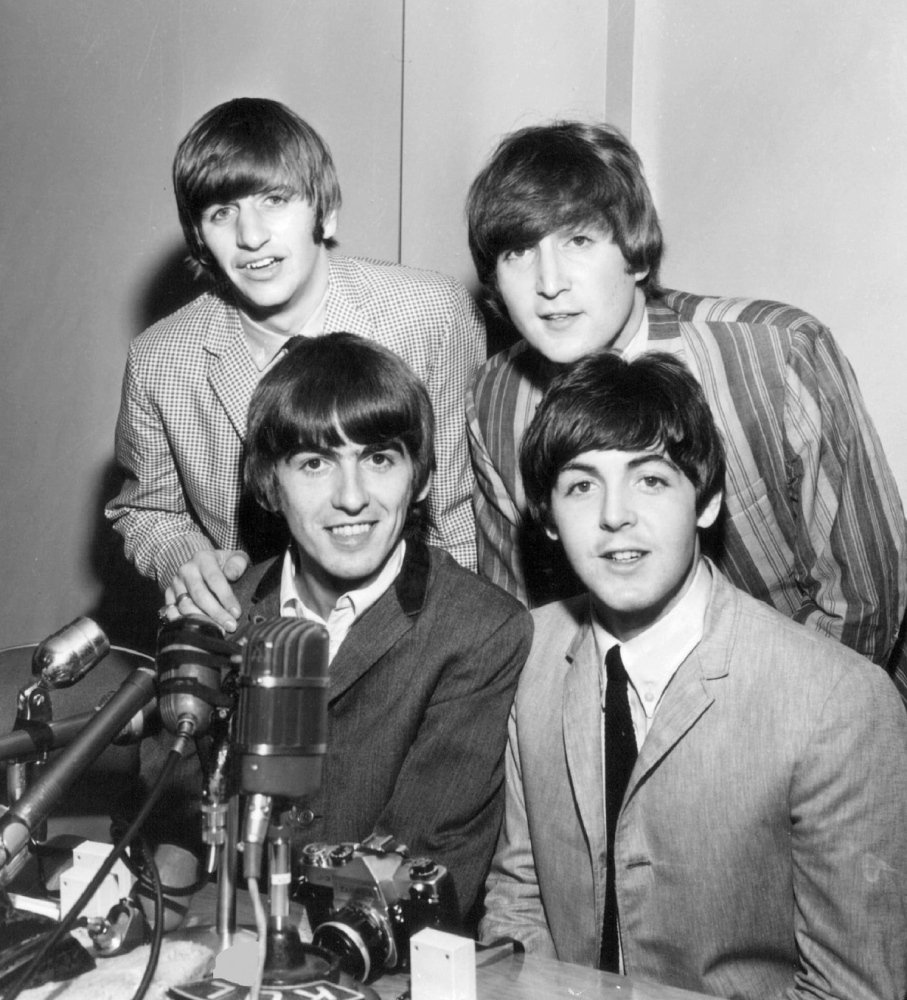 The Beatles, seen here at a press event in Seattle, took America by storm in 1964.