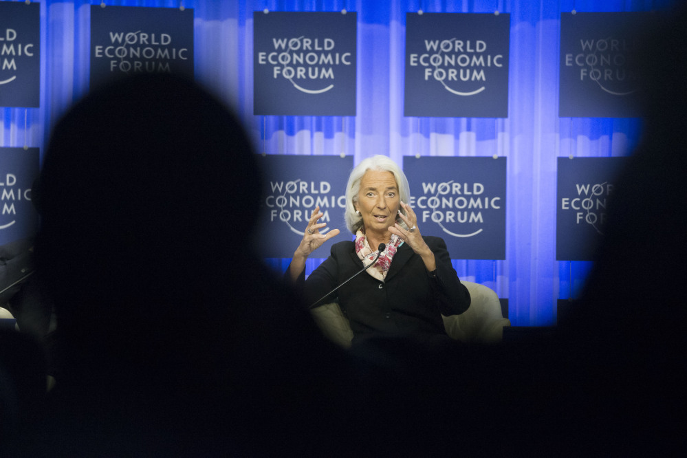 Head of the International Monetary Fund Christine Lagarde gestures as she speaks during a session at the World Economic Forum in Davos, Switzerland, on Saturday.