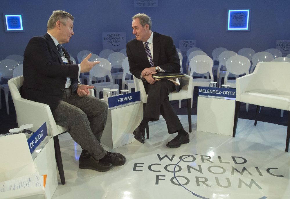 EU Trade Commissioner Karel De Gucht, left, gestures as he speaks with U.S. Trade Representative Michael Froman, before a session at the World Economic Forum in Davos, Switzerland on Saturday.