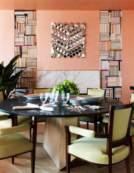 A dining room by designer Jamie Drake for the House Beautiful apartment in the Hearst Designer Visions show house at Walker Tower in New York City takes the books-as-art notion literally. For this apartment, he turned large books spines sides in and stacked them geometrically in wall recesses to flank a fireplace as sculptural art.