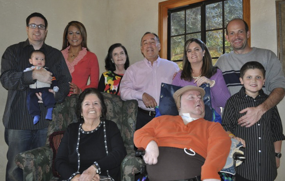 A 2010 photo provided by Paul Cortez shows Mikey Cortez, front row, center, and his family members on Thanksgiving Day.
