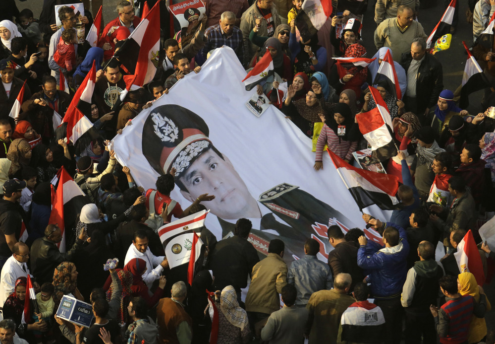 Egyptians wave a poster of Gen. Abdel-Fattah el-Sissi, who removed President Mohammed Morsi, in Tahrir Square, the epicenter of the 2011 uprising, in Cairo on Saturday.