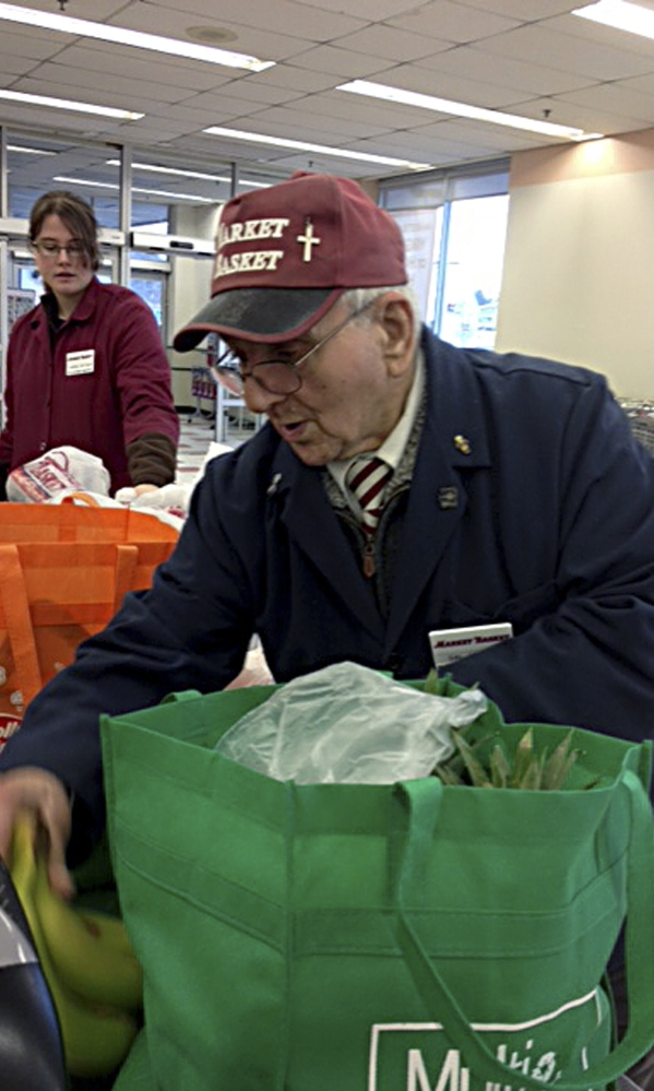 Sal Pilla, 93, bags groceries at the Market Basket in Bellingham, Mass. Pilla was 77 when he started the supermarket job, but had previously worked 30 years in a foundry and had been a Bellingham firefighter for 20 years.