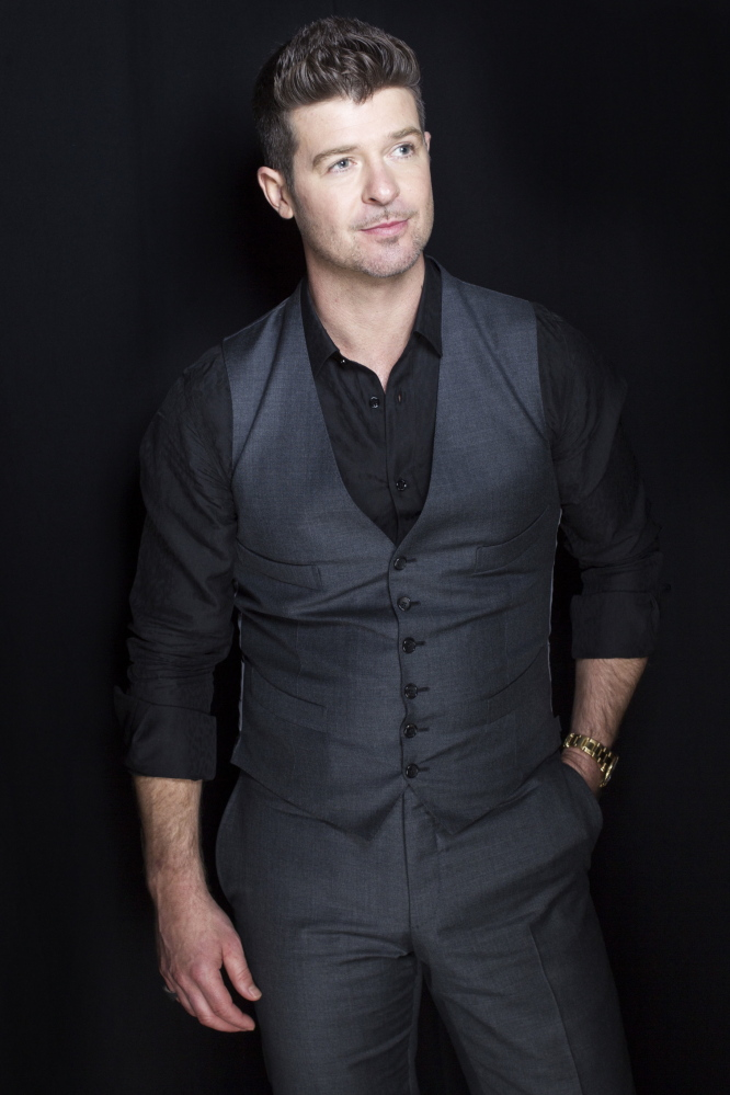 """R&B singer-songwriter Robin Thicke has three nominations, including record of the year for """"Blurred Lines."""""""