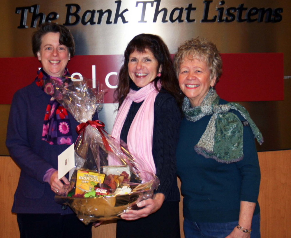 Literacy Volunteers of Greater Sanford Executive Director Ingrid Baily, left, Linda Nadeau of SIS Bank, center, and Jeanne Mahoney, a board member of LVGS, attend the annual Town Club Trivia Challenge fundraiser.