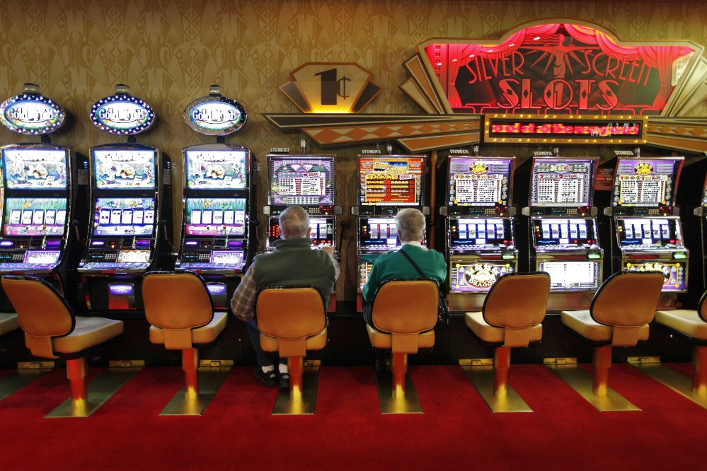 A couple play the slot machines at Hollywood Slots in Bangor. The Legislature is considering bills to expand gambling operations in Maine for the Passamaquoddy tribe, veterans organizations and other groups.