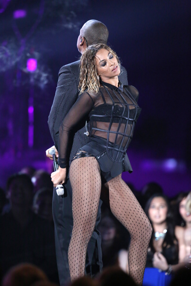 Beyonce, foreground, and Jay-Z perform