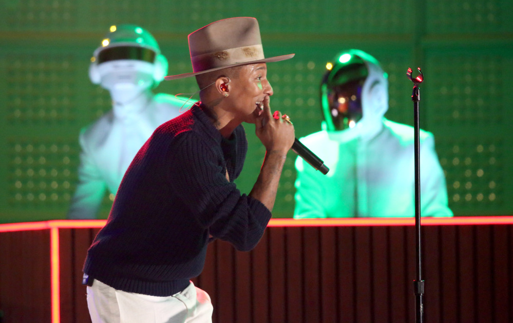 Pharrell Williams performs with Thomas Bangalter, left, and Guy-Manuel de Homem-Christo of Daft Punk at the 56th annual Grammy Awards in Los Angeles on Sunday.