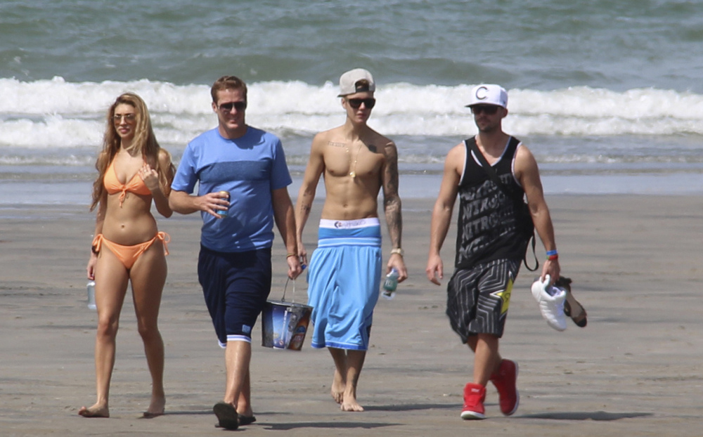 Justin Bieber, second right, and Chantel Jeffries, far left, walk with unidentified people on a beach in Punta Chame, Panama, on Saturday.