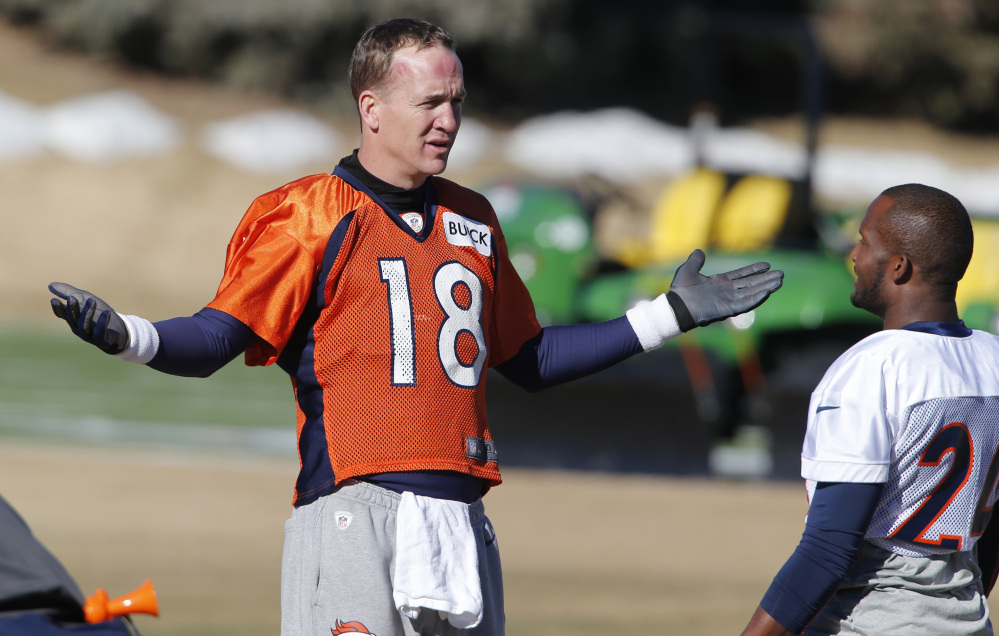 Denver Broncos quarterback Peyton Manning (18) talks with cornerback Champ Bailey (24) during NFL football practice at the team's training facility in Englewood, Colo., Saturday.