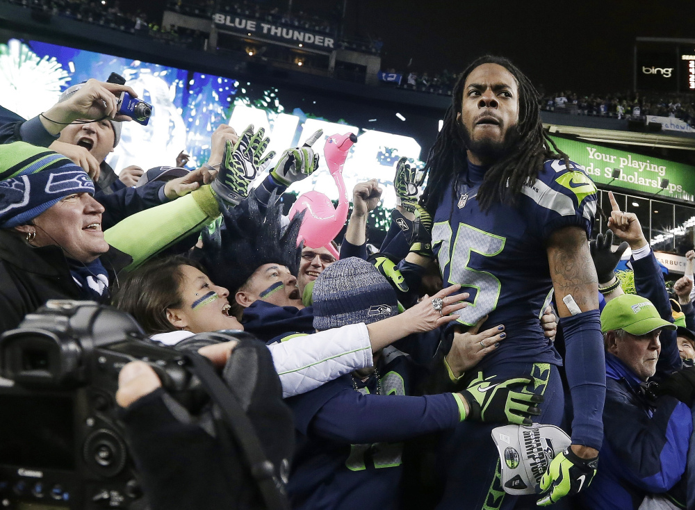 In this Jan. 19, 2013, file photo, Seattle Seahawks' Richard Sherman celebrates with fans after after the NFC championship NFL football game against the San Francisco 49ers in Seattle.