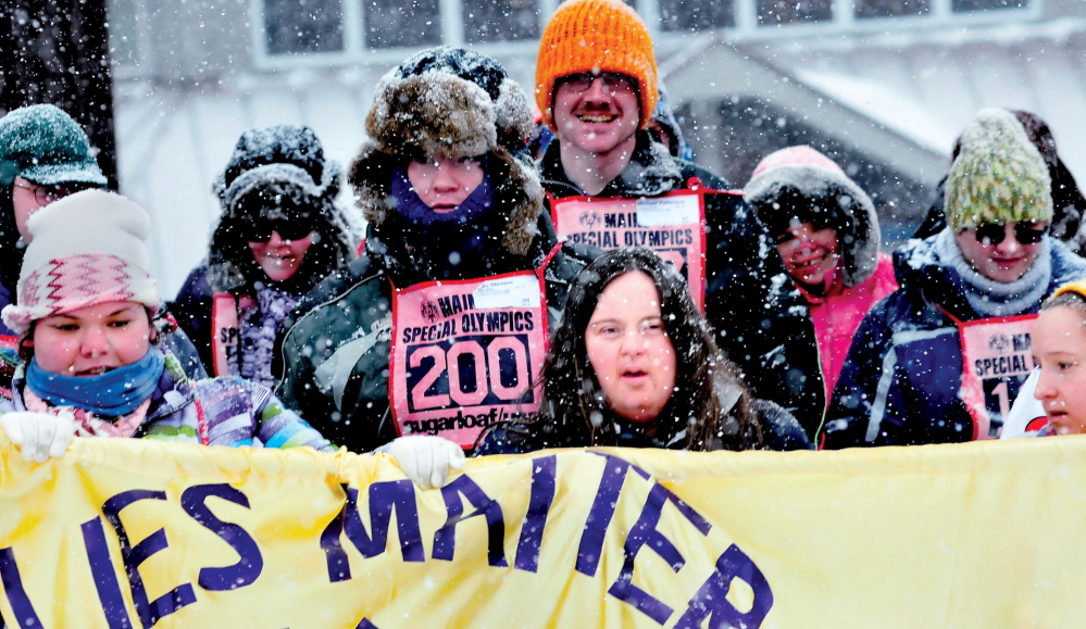 Caitlin Killarney, center, joins other athletes with Families Matter Inc. of Waterville during opening ceremonies of the 45th annual Special Olympics Maine Winter Games held at Sugarloaf USA on Monday.