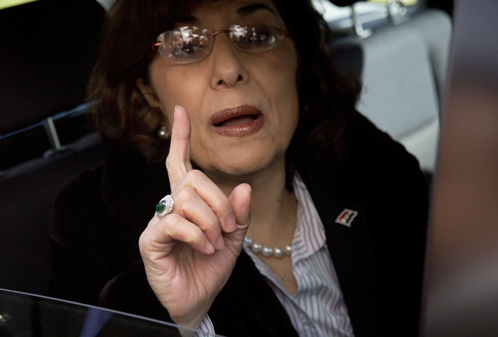 Bouthaina Shaaban, adviser to Syrian President Assad, gestures as she leaves after meeting with the Syrian opposition at the United Nations headquarters in Geneva, Switzerland, on Monday. Syria's opposition says there has been no progress on aid convoys reaching a besieged city in central Syria and the release of prisoners from government jails.