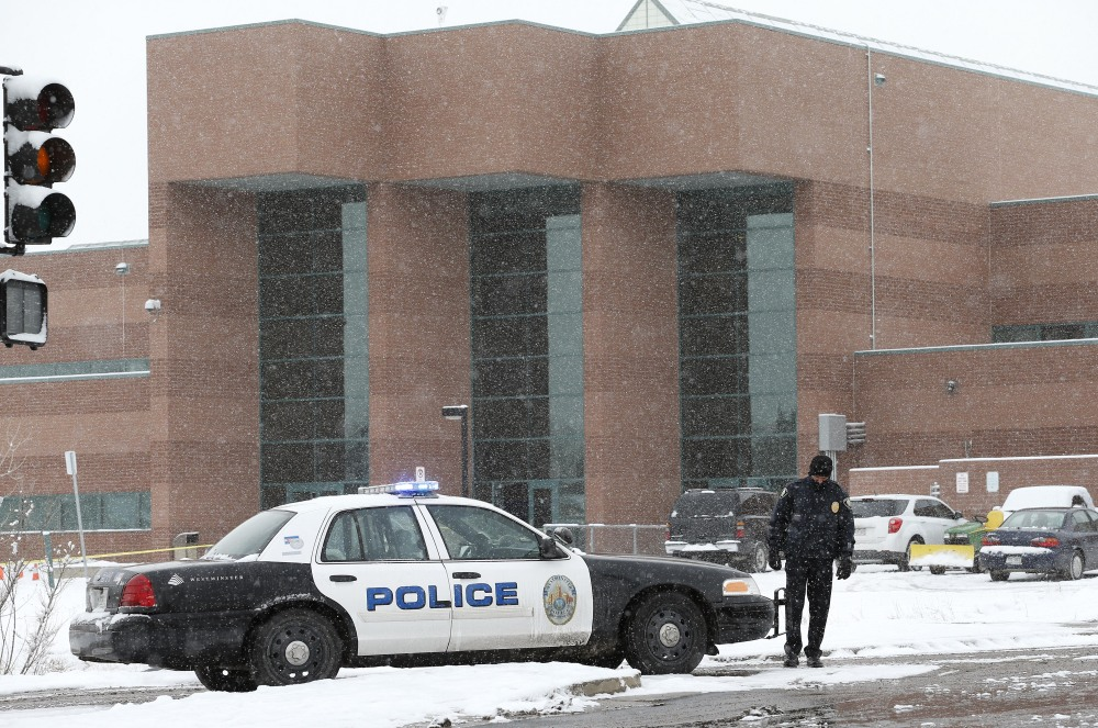 A police cruiser blocks the entrance to Standley Lake High School in Westminster, Colo., where classes were canceled after an apparent suicide attempt by a student Monday.