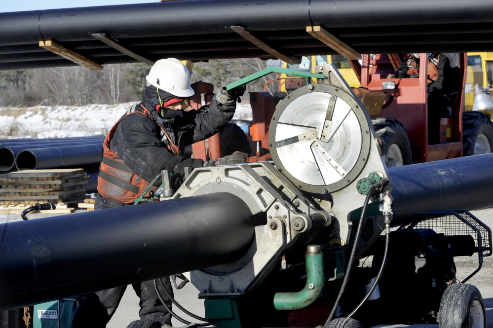 Kevin Lee fuses plastic dredging pipe at the Ferry Beach boat launch Friday in Scarborough, which the Army Corps of Engineers will use to dredge the Scarborough River.
