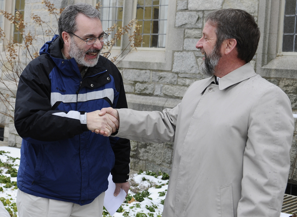 Pastor Kenneth Miller, right, greets supporter Dwight Nisly before a hearing Monday at the University of Connecticut in Miller's appeal of his conviction for aiding a parental kidnapping.