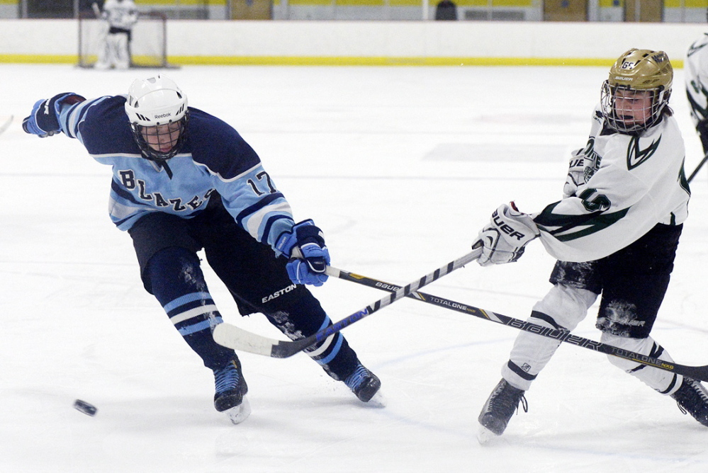 Bonny Eagle's Tanner McClure shoots the puck before Westbrook's Matthew Kelly can defend. McClure scored a first-period goal for the Scots.