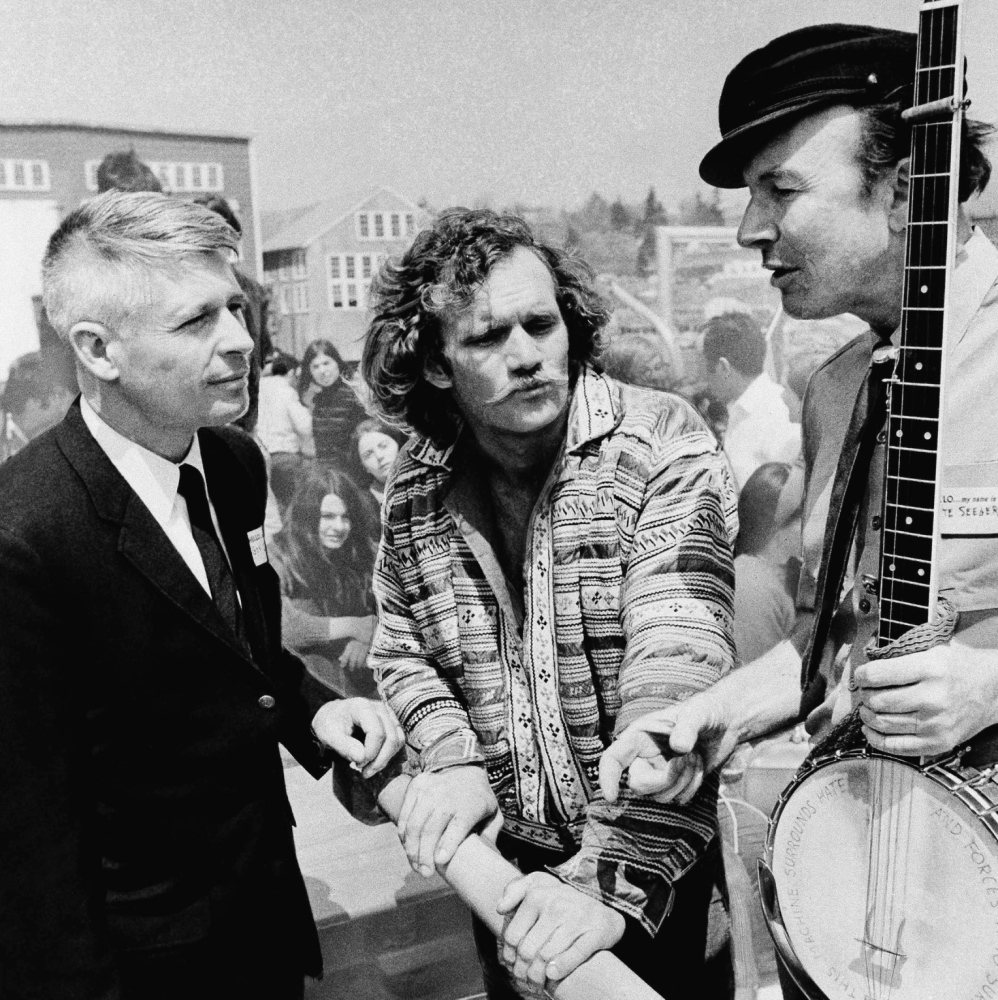 Maine Gov. Kenneth Curtis, left, skipper Alan Aunapu, center, and folk singer Pete Seeger talk in May 1969 at the launching ceremony for Seeger's sloop Clearwater in South Bristol.