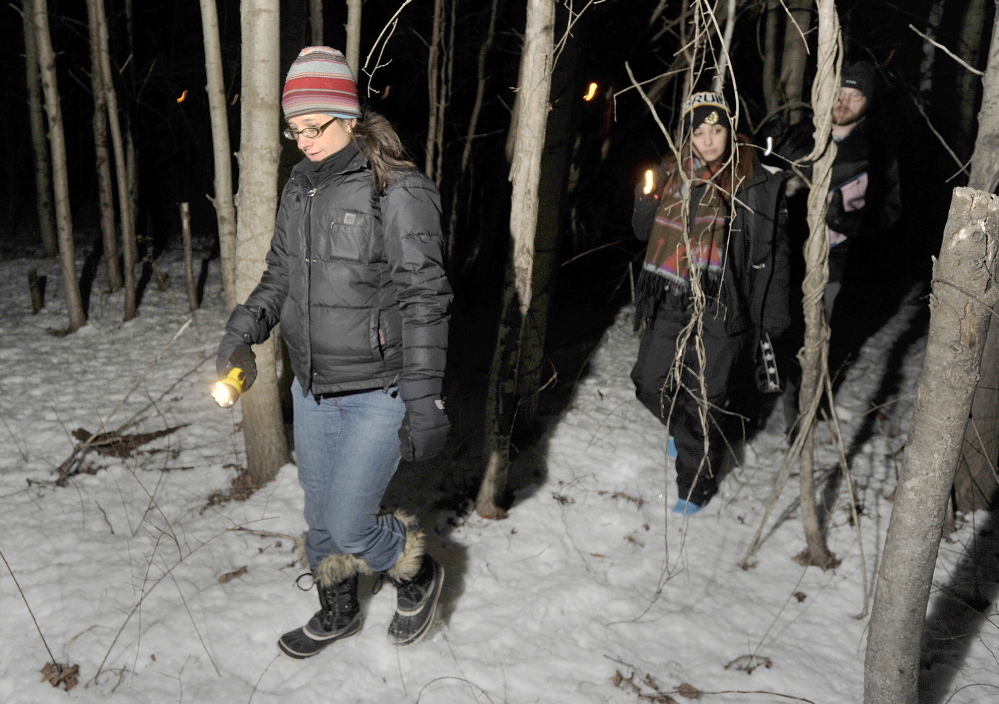Volunteer Amy Pulaski and members of her team looked for homeless people in wooded areas along the Fore River in Portland Wednesday night. They did not find any campers in the area.