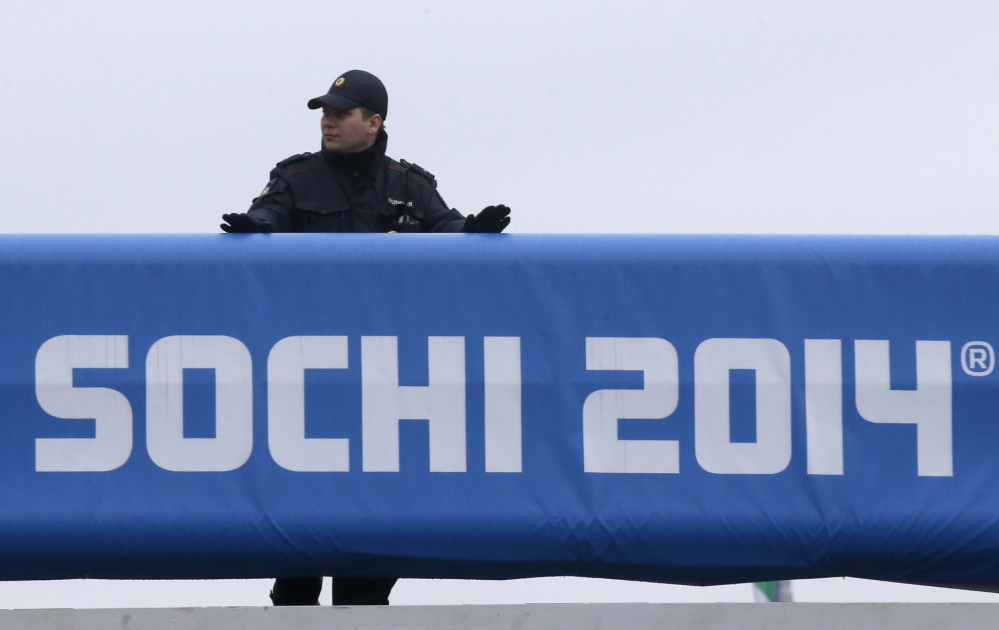 A Russian police officer keeps watch at the Olympic Park in Sochi on Wednesday. Russia is deploying more than 50,000 police and soldiers during the Winter Games from Feb. 7 to 23.