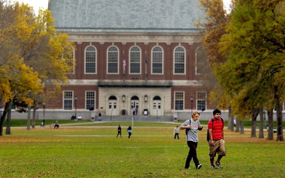 Dmitri Onishchuk, a freshman from Oakdale, N.Y., and Daniel Norwood of Acton, a junior, walk through the mall at the University of Maine, in Orono, on a fall afternoon.