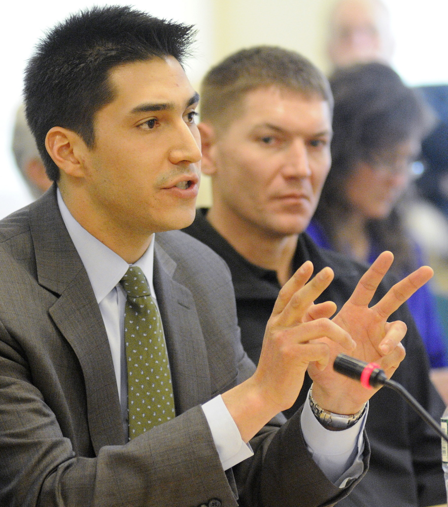 Attorney Michael-Corey Hinton addresses the Marine Resources Committee on Wednesday, Jan. 29, 2014 in Augusta on behalf of Native American elver fisherman with Passamaquoddy Vice-Chief Clayton Sockabasin in the background.