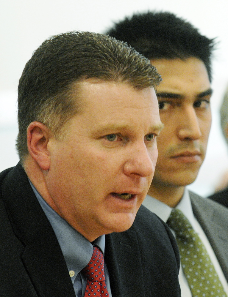 Patrick Keliher, Commissioner of the Maine Department of Marine Resources, left, addresses the Marine Resources Committee on Wednesday, Jan. 29, 2014 in Augusta as Attorney Michael-Corey Hinton, representing Native American elver fisherman, listens to the testimony.