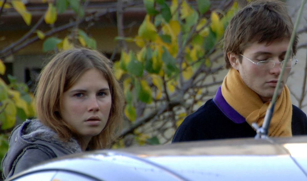 Amanda Knox and then-boyfriend Raphael Sollecito stand outside the murder scene in Perugia, Italy, in 2007.