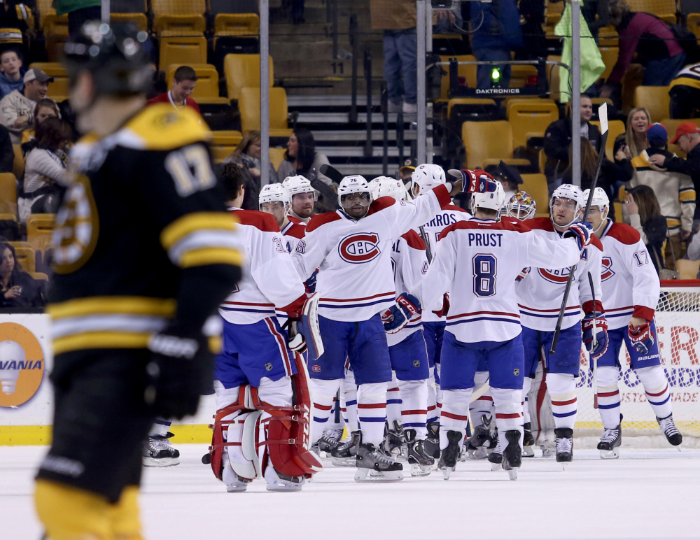 Montreal Canadiens defenseman P.K. Subban, center, celebrates with teammates after defeating the Boston Bruins 4-1 Thursday in Boston.
