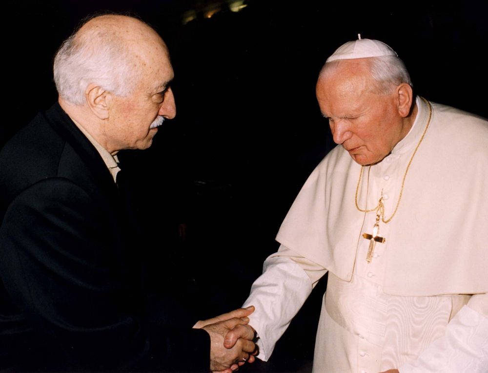 Turkish Muslim spiritual leader Fethullah Gulen shakes hands with Pope John Paul II when they met at the Vatican in 1998. One of the proposed charter schools that moved ahead Thursday would be run by his followers, but is not intended to be a religious school.