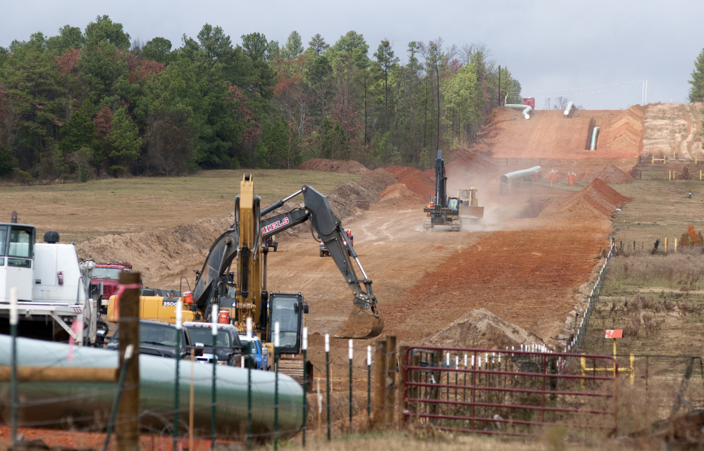 In this Dec. 3, 2012, photo, crews work on construction of the TransCanada Keystone XL Pipeline east of Winona, Texas.