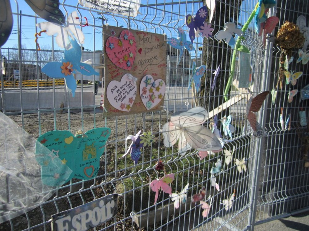 Tributes shaped like butterflies and hearts decorate a fence in November in Lac-Megantic, Quebec. The items were placed there in honor of some of the 47 people killed last July 6 when a runaway Montreal, Maine & Atlantic Railway train derailed and exploded.