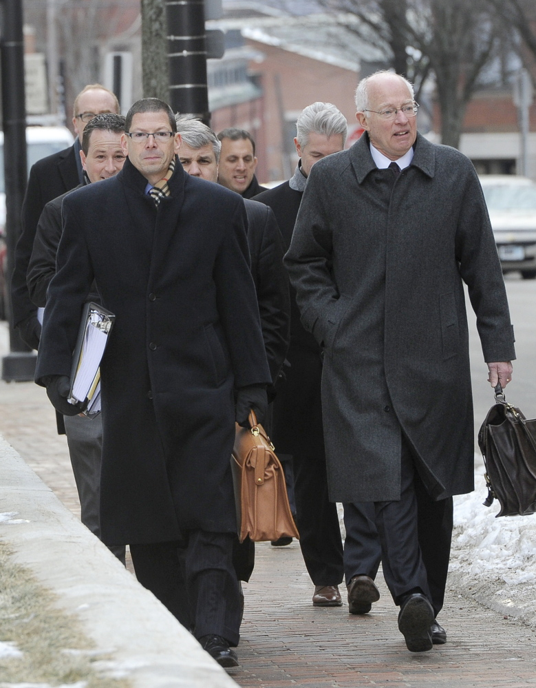 Attorney Peter DeTroy, right, who represents a petroleum transportation firm, and other lawyers walk to a federal bankruptcy hearing in Portland on Friday.