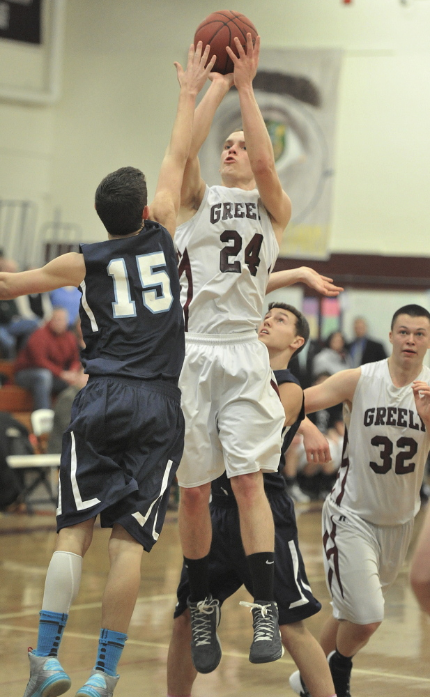 Connor Hanley, who finished with a game-high 15 points for Greely, lofts a jumper in the lane over Matthew Pratt of York.