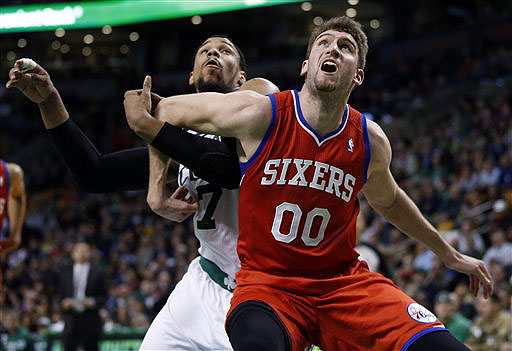 Philadelphia 76ers center Spencer Hawes boxes out Boston Celtics center Jared Sullinger in the second half Wednesday night in Boston. TD Garden